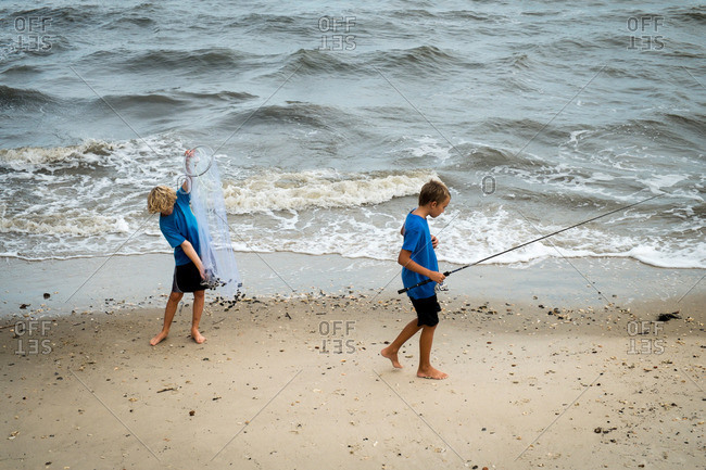Charleston, South Carolina - August 29, 2015: Brothers fishing at the beach in Charleston, South Carolina