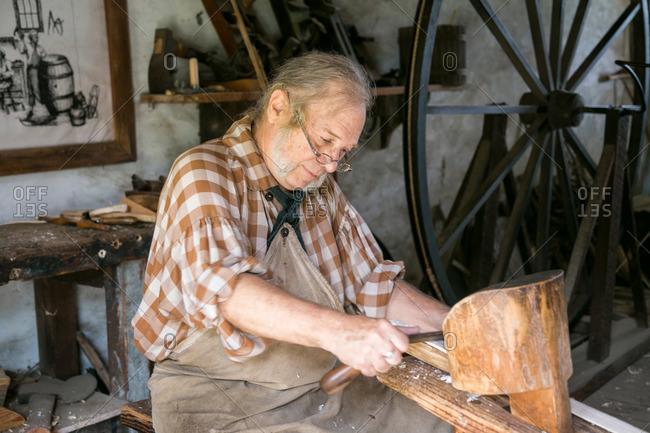 Mt. Pleasant, South Carolina - August 28, 2015: Barrel maker working at Middleton Plantation in Mt. Pleasant, South Carolina