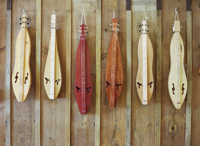 Dulcimers hanging on a wooden wall