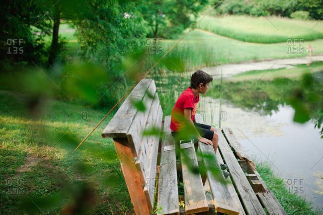 Boy taking a break from fishing