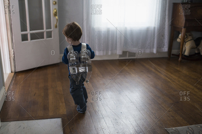 Boy with homemade rocket jet pack toy