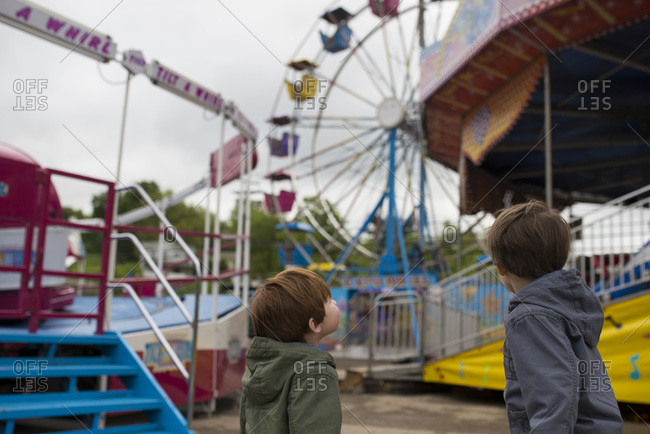 Two small boys look at empty fair ground