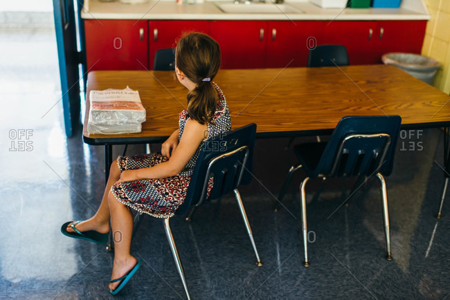 Girl seated at a table in a classroom