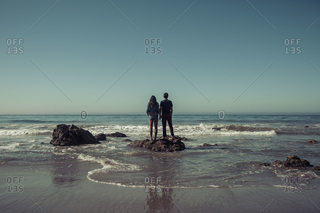 Young couple holding hands on a beach