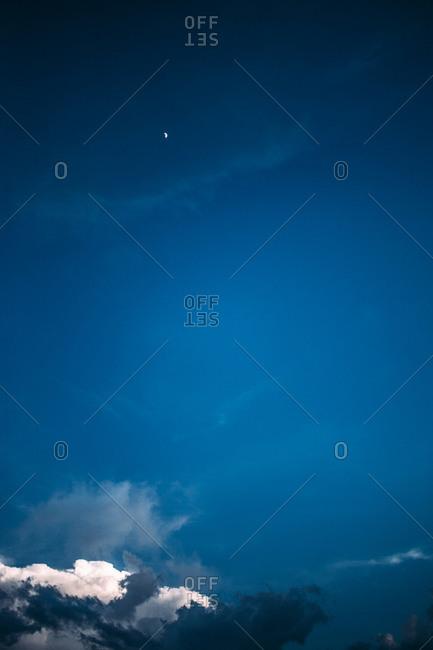 Deep blue sky and half moon
