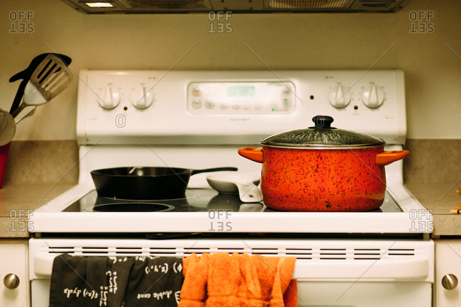 Stove with pots and pans and towels