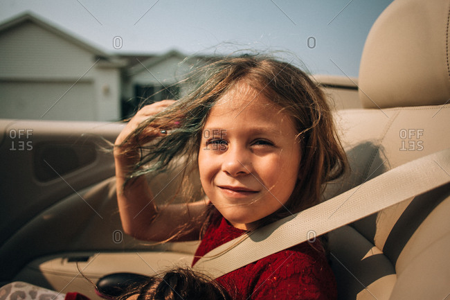 Little girl sitting in a convertible