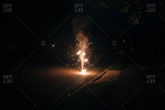 Fireworks bursting in a street