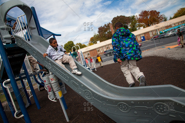 Washington D.C. - October 18, 2012: Students playing on a slide at Stanton Elementary