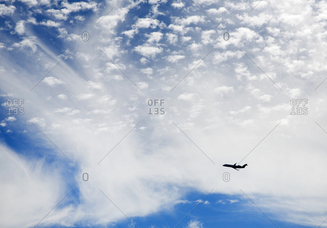 Plane taking off against blue sky