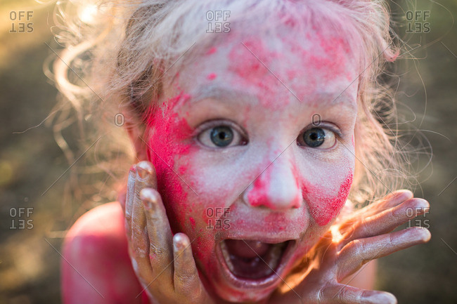 Girl covered in powder making shocked face