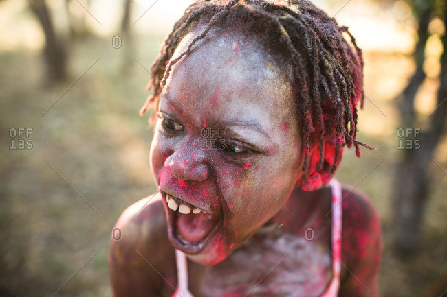 Girl covered in powder making silly face