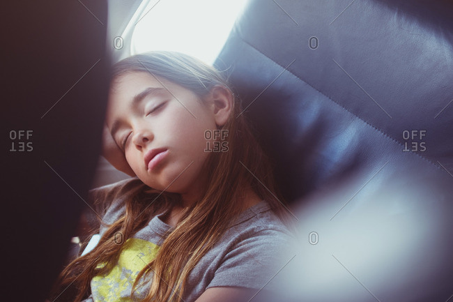 Girl fast asleep in an airplane