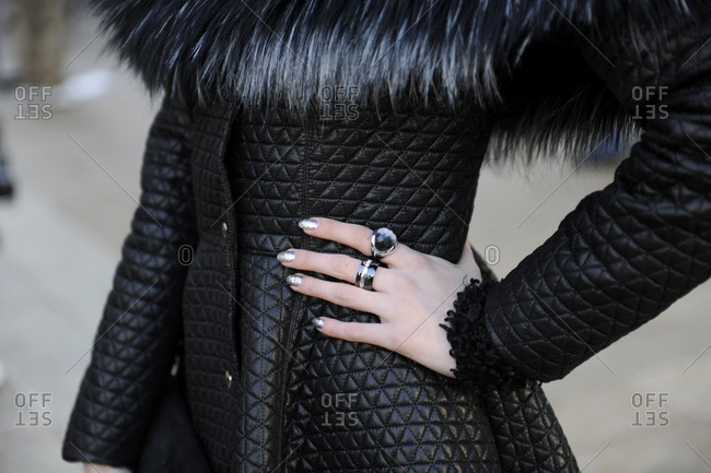 A woman in a fur-lined quilted leather jacket