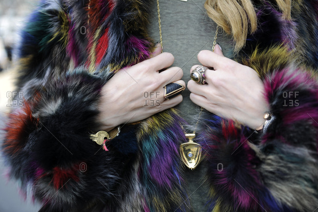 A woman wearing a multi-colored fur coat
