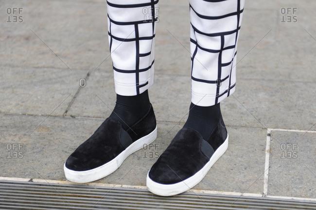 A man wearing suede slip-ons