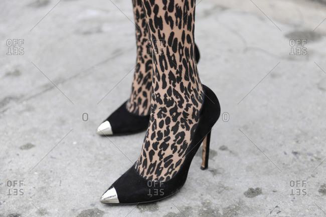A woman in leopard print tights