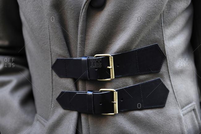Black straps on a gray coat