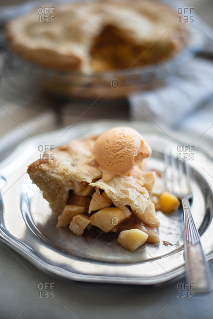 Slice of apple pie served on a plate