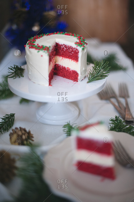 Red velvet cheesecake slice served in holiday setting