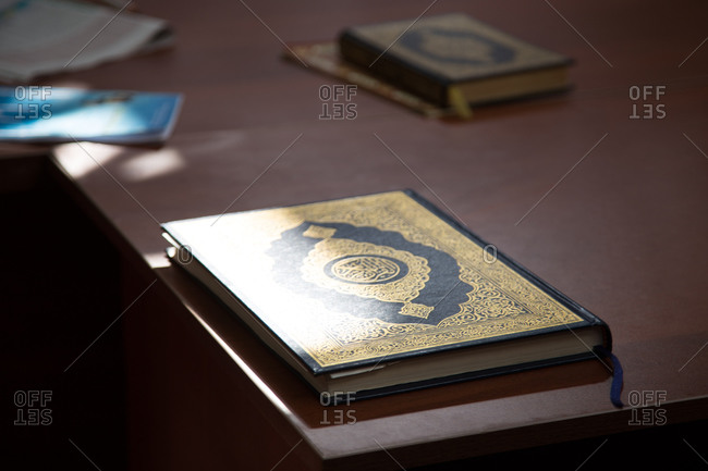 Prayer book on the edge of table in mosque