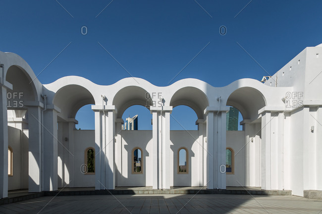Astana, Kazakhstan - July 18, 2015: Row of four white stucco archways with windows at the Nur-Astana Mosque