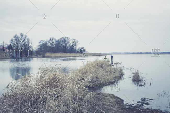 Lonely angler at river Oder