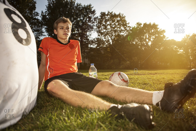 Two soccer players on soccer pitch having abreak