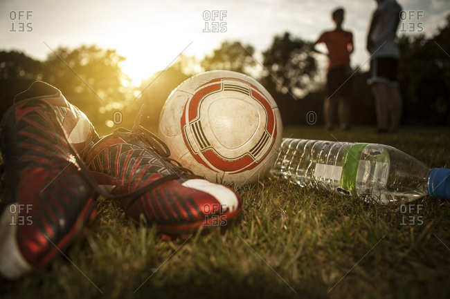 Ball and bottle of water on soccer pitch