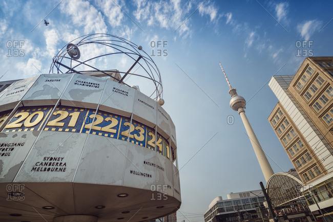 Berlin, Germany - August 16, 2015: Urania world clock and Berlin TV tower at Alexanderplatz, Berlin
