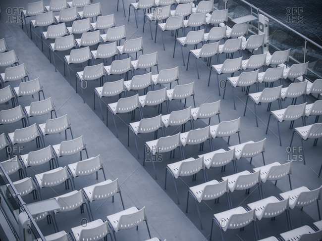 Empty rows of chairs on a ferry