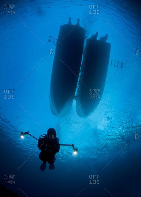 Scuba diver with lamps, Palau