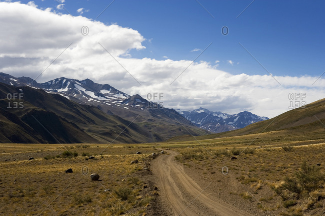Dirt track running through dramatic landscape in Argentina