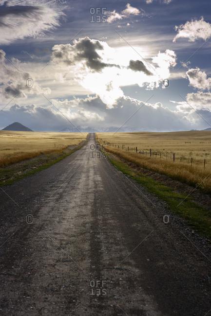 Dirt road traveling through plains in Wyoming