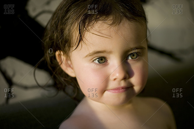 Portrait of a little girl with wet hair
