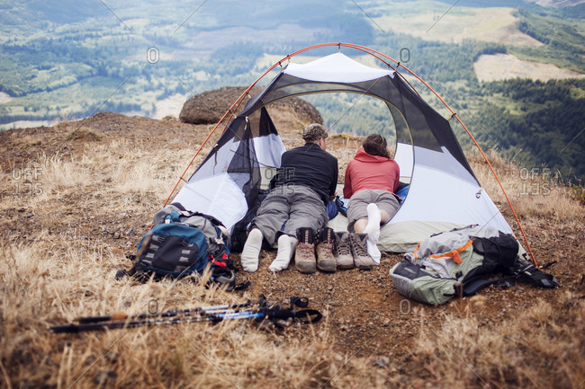 Couple enjoying view from their tent in Oregon