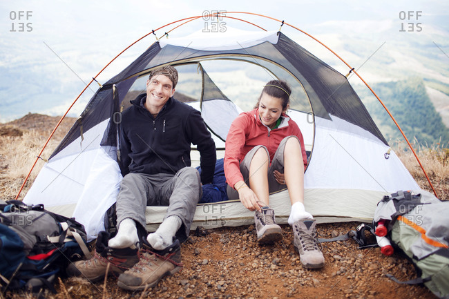 Couple camping on a mountaintop in Oregon
