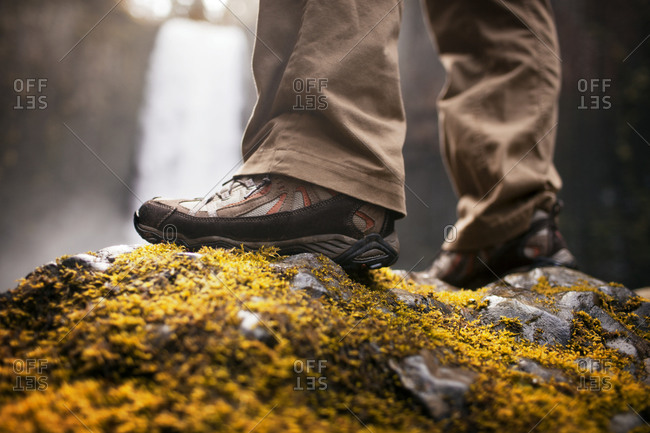 Hiking shoes on moss covered rocks in Oregon
