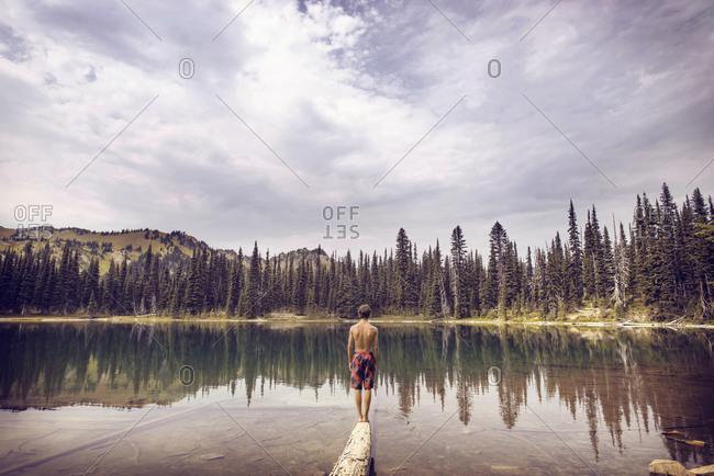 Boy at Sunrise Lake in Mt Rainier National Park, Washington