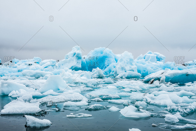 Blue icebergs in glacial lake in Iceland