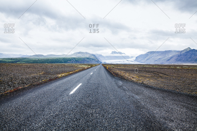 Desolate road through the Icelandic tundra