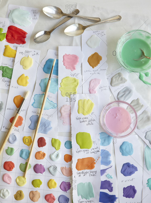 Color swatches of icing with brushes