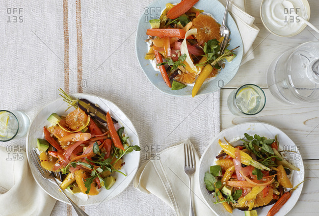 Roasted carrot salad and glasses of water