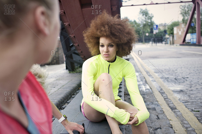 Young women talking before jogging