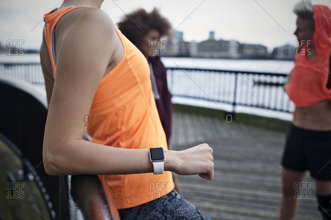 Woman wearing a fitness watch relaxes
