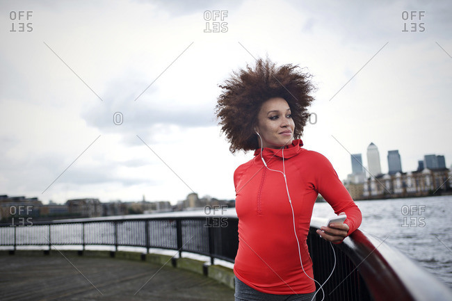 Young woman listening to music before a run