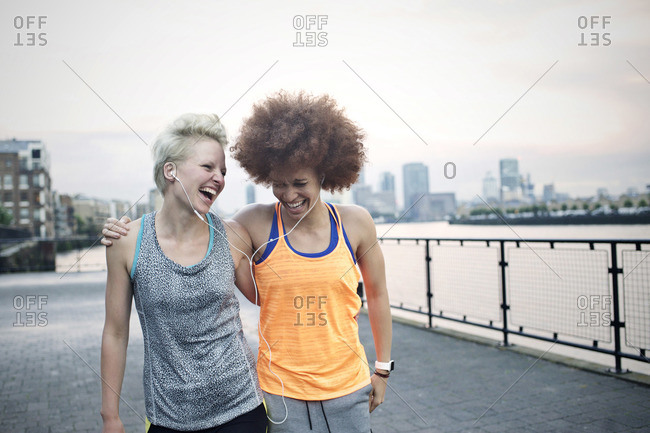 Women sharing headphones