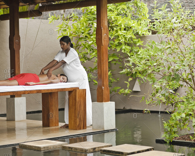 Woman receiving a massage in a luxurious spa