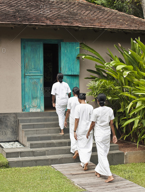 Spa therapists walk to a spa treatment room at luxury resort
