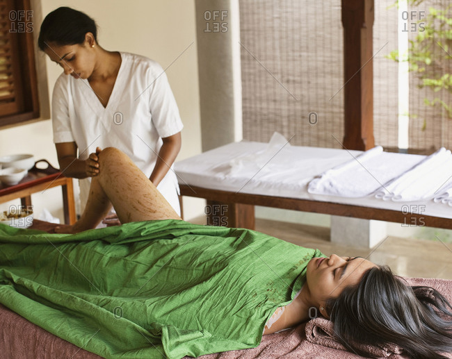 Young woman receiving a body wrap spa treatment